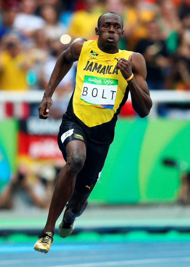 Usain Bolt easily progressed to the semi-finals
