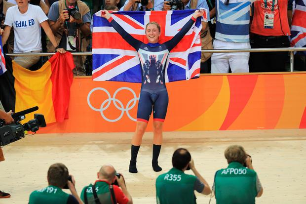 Laura Trott of Great Britain celebrates winning gold in the women's Omnium Points race on Day 11 of the Rio 2016 Olympic Games at the Rio Olympic Velodrome on August 16, 2016 in Rio de Janeiro, Brazil. (Photo by Tom Pennington/Getty Images)
