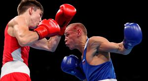 RIO DE JANEIRO, BRAZIL - AUGUST 16: Vladimir Nikitin (R) of Russia fights Michael John Conlan of Ireland in the boxing Men's Bantam (56kg) Quarterfinal 1 on Day 11 of the Rio 2016 Olympic Games at Riocentro on August 16, 2016 in Rio de Janeiro, Brazil. (Photo by Christian Petersen/Getty Images)