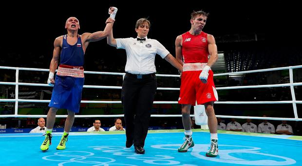 RIO DE JANEIRO, BRAZIL - AUGUST 16: Vladimir Nikitin (L) of Russia celebrates his victory over Michael John Conlan of Ireland in the boxing Men's Bantam (56kg) Quarterfinal 1 on Day 11 of the Rio 2016 Olympic Games at Riocentro on August 16, 2016 in Rio de Janeiro, Brazil. (Photo by Christian Petersen/Getty Images)