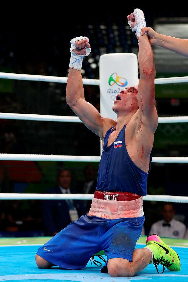 RIO DE JANEIRO, BRAZIL - AUGUST 16: Vladimir Nikitin of Russia celebrates his victory over Michael John Conlan (not pictured) of Ireland in the boxing Men's Bantam (56kg) Quarterfinal 1 on Day 11 of the Rio 2016 Olympic Games at Riocentro on August 16, 2016 in Rio de Janeiro, Brazil. (Photo by Christian Petersen/Getty Images)