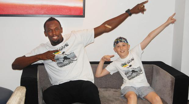 Alex Corr with hero Usain Bolt