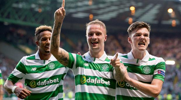 Celtic's Leigh Griffiths celebrates scoring his side's third goal of the game with teammate Kieran Tierney during the UEFA Champions League qualifying play-off, first leg match at Celtic Park, Glasgow. PA