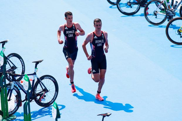 Alistair Brownlee and Jonathan Brownlee of Great Britain compete during the Men's Triathlon at Fort Copacabana on Day 13 of the 2016 Rio Olympic Games on August 18, 2016 in Rio de Janeiro, Brazil. (Photo by Adam Pretty/Getty Images)