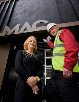 Mascott construction director Alwyn Campbell and MAC chief executive Anne McReynolds as the company completed its building work on the theatre in 2013