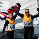 Hannah Mills (left) of Great Britain and Saskia Clark of Great Britain celebrate winning gold in the Women's 470 class at the Marina da Gloria on Day 13 of the 2016 Rio Olympic Games on August 18, 2016 in Rio de Janeiro, Brazil. (Photo by Clive Mason/Getty Images)