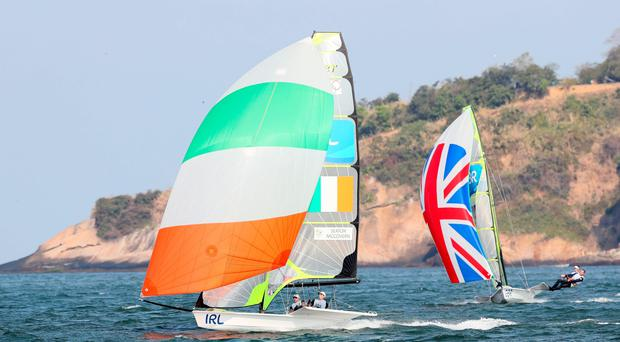 Ireland's Ryan Seaton and Matthew McGovern (left) and Great Britain's Dylan Fletcher-Scott and Alain Sign in action during the men's 49er Medal Race at Marina da Gloria on the thirteenth day of the Rio Olympic Games, Brazil. PA
