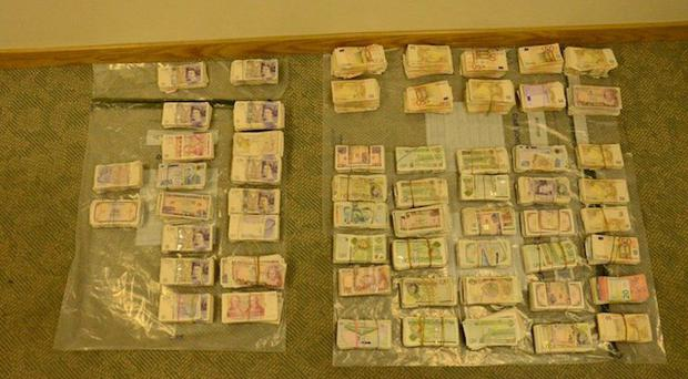 Banknotes seized by the PSNI during a major drugs investigation in Armagh