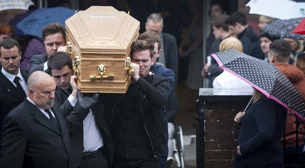 The coffin of the late Stevie Martin (Rainy Boy Sleep) is carried from the Derry/Donegal Christian Fellowship Church on Northland Road, Londonderry on Friday morning.