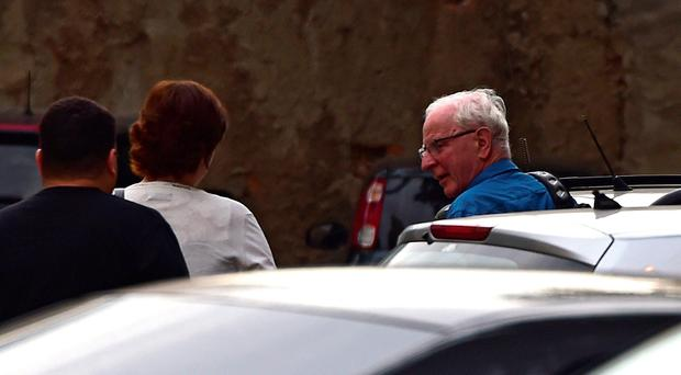 International Olympic Committee (IOC) member Patrick Hickey (R) arrives at the police station after being arrested on allegations of taking part in a black market ticket ring, on August 18, 2016, in Rio de Janeiro, Brazil. AFP/Getty Images