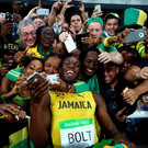 Usain Bolt of Jamaica celebrates with fans after winning the Men's 200m Final on Day 13 of the Rio 2016 Olympic Games at the Olympic Stadium on August 18, 2016 in Rio de Janeiro, Brazil. (Photo by Ryan Pierse/Getty Images)