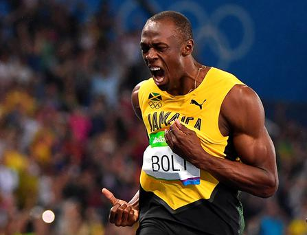 Star attraction: Usain Bolt soaks up the adulation at the Olympic Stadium in Rio