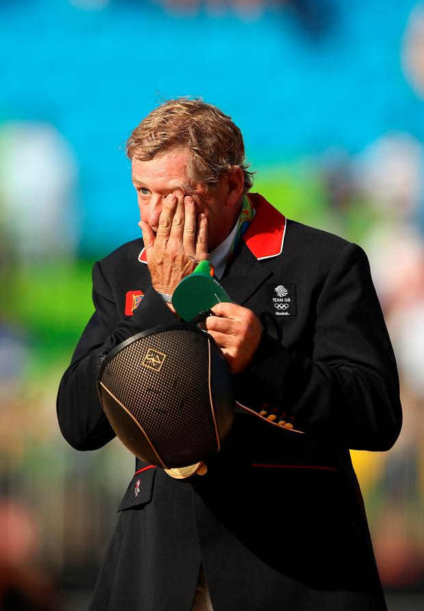 Tearful: An emotional Nick Skelton on the podium after winning gold
