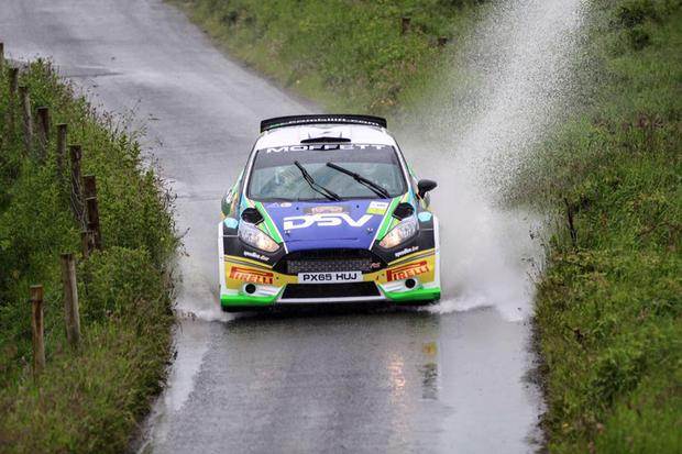 Making a splash: Josh Moffett powers through the Mary Gray stage in his R5 Ford Fiesta on day one of the Ulster Rally