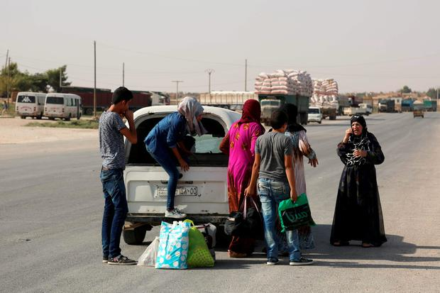 Syrian Kurdish civilians flee reported shelling in the northeastern governorate of Hasakah, toward the city of Qameshli, on August 19, 2016. Syrian regime warplanes bombarded the northeastern city of Hasakeh for the second day on Friday, targeting positions held by Kurdish forces, the Syrian Observatory for Human Rights and a journalist in the city said. AFP/Getty Images