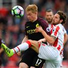 Stoke City's Welsh midfielder Joe Allen (R) vies with Manchester City's Belgian midfielder Kevin De Bruyne during the English Premier League football match between Stoke City and Manchester City at the Bet365 Stadium in Stoke-on-Trent, central England on August 20, 2016. AFP/Getty Images