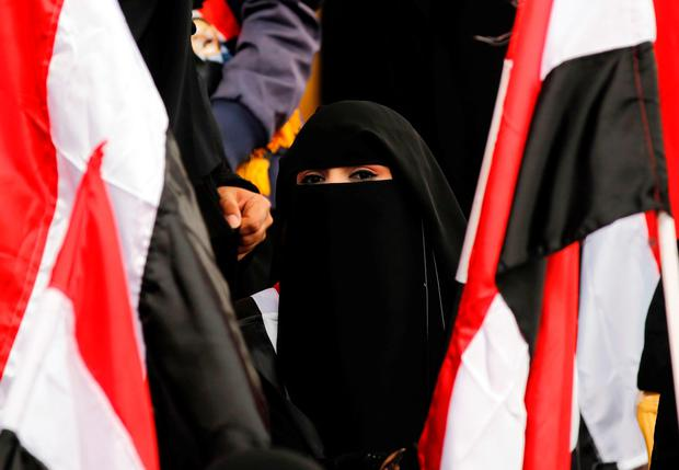 A Yemeni woman waves the national flag during a gathering in support of the Huthi-led parliament, in the capital Sanaa on August 20, 2016. AFP/Getty Images