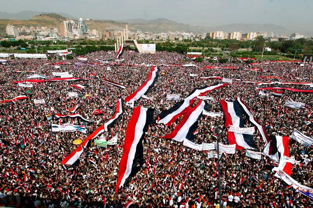 Yemeni's wave the national flag during a gathering in support of the Huthi-led parliament, in the capital Sanaa on August 20, 2016. AFP/Getty Images