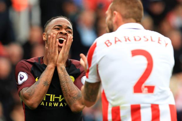 Manchester City's English midfielder Raheem Sterling reacts during the English Premier League football match between Stoke City and Manchester City at the Bet365 Stadium in Stoke-on-Trent, central England on August 20, 2016. AFP/Getty Images