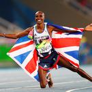 Mohamed Farah of Great Britain reacts after winning gold in the Men's 5000 meter Final on Day 15 of the Rio 2016 Olympic Games at the Olympic Stadium on August 20, 2016 in Rio de Janeiro, Brazil. (Photo by Ian Walton/Getty Images)