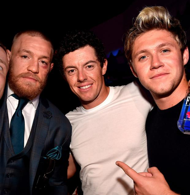 LAS VEGAS, NV - AUGUST 20: Mixed martial artist Conor McGregor (2nd L) and singer Niall Horan (R) celebrate McGregor's UFC 202 victory during the official after-fight party at Intrigue Nightclub at Wynn Las Vegas on August 20, 2016 in Las Vegas, Nevada. (Photo by David Becker/Getty Images for Wynn Las Vegas)