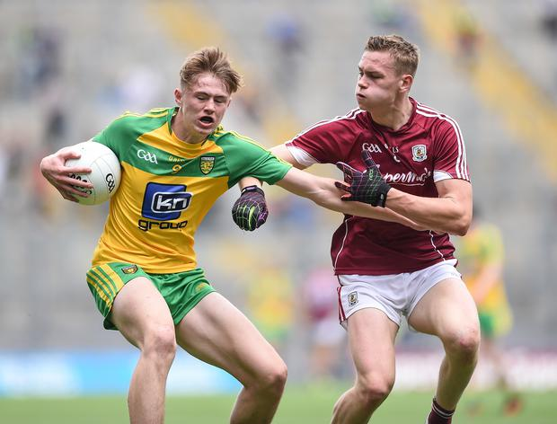 Gripping affair: Donegal's Kieran Gallagher clashes with Sean Raftery at Croke Park yesterday