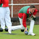 On a roll: Daniel Donnan competes for Donaghadee against Balmoral