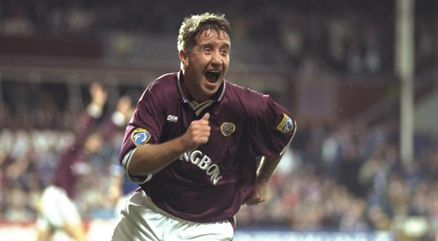 Fury: John Robertson was at Hearts when a merger with Hibs was mooted
