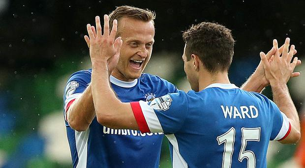 Blues brothers: Sammy Clingan and Sean Ward hail the comfortable win over Glenavon at Windsor Park
