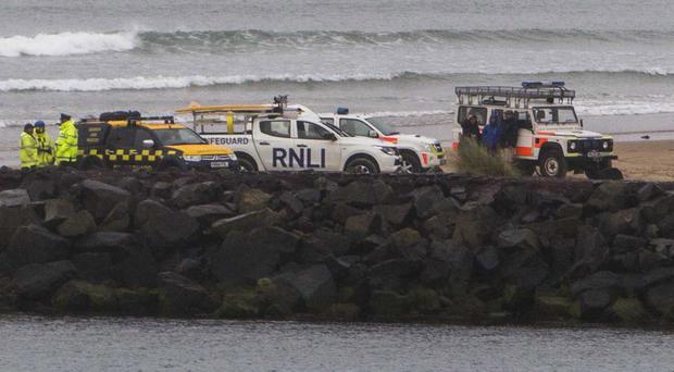 Rescue services search the River Bann on Sunday evening after clothes were found at the Barmouth
