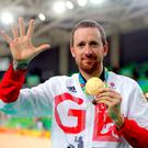 Bradley Wiggins celebrates with his gold medal following victory in the men's team pursuit final