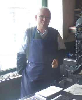 Andy Marshall, visitor guide at the Ulster Folk & Transport Museum, at Baird's print shop