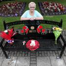 Mitchell Bertram's mother Catherine unveils a memorial bench in her home village of Cramlington in Northumberland