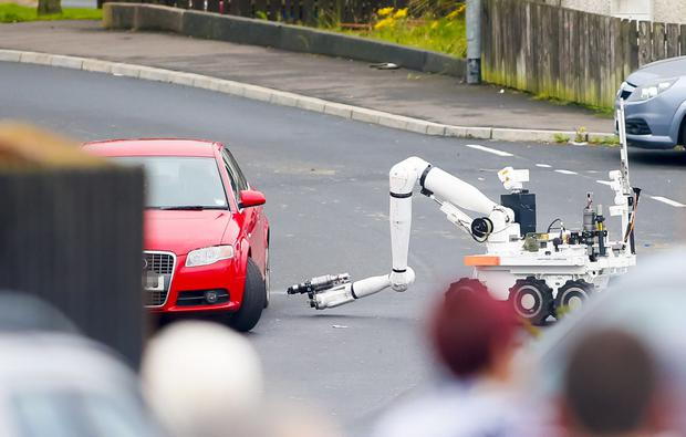Police and ATO examine a red Audi at the centre of a security alert in the Castlemara Drive area of Carrickfergus on 23rd August 2016 ( Photo by Kevin Scott / Presseye )