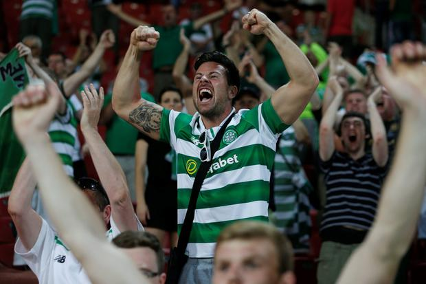 Celtic fans cheer before the the Champions League qualifying playoffs second leg soccer match in against Hapoel in Beersheba, Israel, Tuesday, Aug. 23, 2016. (AP Photo/Ariel Schalit)