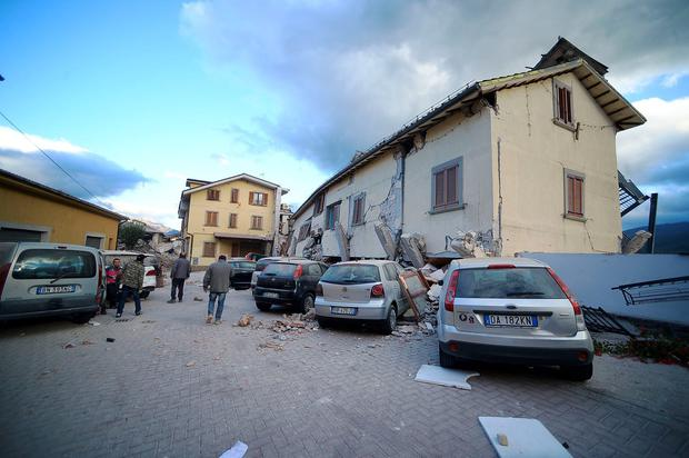 Residents walk among damaged homes after a strong heartquake hit Amatrice on August 24, 2016. Central Italy was struck by a powerful, 6.2-magnitude earthquake in the early hours, which has killed at least three people and devastated dozens of mountain villages. Numerous buildings had collapsed in communities close to the epicenter of the quake near the town of Norcia in the region of Umbria, witnesses told Italian media, with an increase in the death toll highly likely. / AFP PHOTO / FILIPPO MONTEFORTEFILIPPO MONTEFORTE/AFP/Getty Images