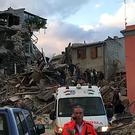 Rescuers searching a collapsed building in Amatrice, central Italy, where a 6.1 earthquake struck just after 3:30 a.m. The quake was felt across a broad section of central Italy, including the capital Rome where people in homes in the historic center felt a long swaying followed by aftershocks. (AP Photo)