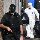 Forensics remove items from a house in Larne. Photo Colm Lenaghan/Pacemaker Press