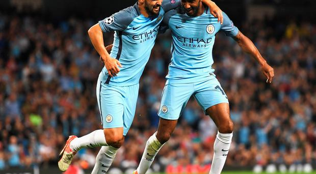 MANCHESTER, ENGLAND - AUGUST 24: Fabian Delph (R) of Manchester City celebrates scoring the opening goal with Nolito during the UEFA Champions League Play-off Second Leg match between Manchester City and Steaua Bucharest at Etihad Stadium on August 24, 2016 in Manchester, England. (Photo by Michael Regan/Getty Images)