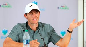 Hand held up: Rory McIlroy speaking last night ahead of The Barclays PGA Tour FedExCup Play-Off tournament in New York
