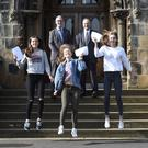 Education Minister Peter Weir welcomes GCSE examination results with Methodist College, pupils Lauren Bell, Zoe Hagan and Caitriona Marsh. Picture: Michael Cooper