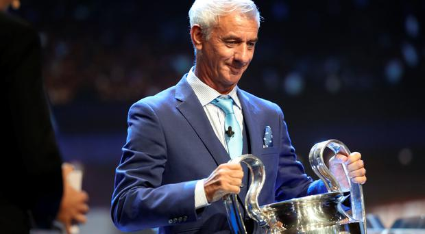 Liverpool football legend Ian Rush holds the Champions League trophy at the start of the UEFA Champions League Group stage draw ceremony, on August 25, 2016 in Monaco. AFP/Getty Images