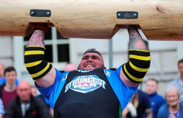 Sean O'Hagan from Ireland lifts a log during the UK Strongest Man 2016 heats at Belfast City Hall, Belfast. PA