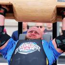 Pa O'Dwyer from Ireland lifts a log during the UK Strongest Man 2016 heats at Belfast City Hall, Belfast. PA