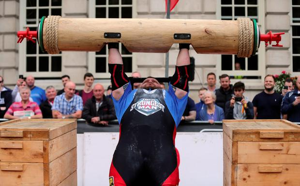 Ed Hall from England lifts a log during the UK Strongest Man 2016 heats at Belfast City Hall, Belfast. PA