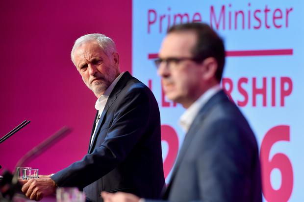 Jeremy Corbyn and Owen Smith attend a Labour Party leadership debate on August 25, 2016 in Glasgow, Scotland. (Photo by Jeff J Mitchell/Getty Images)