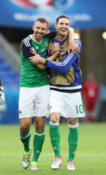 Northern Ireland's Gareth McAuley and Kyle Lafferty celebrate after the win over Ukraine in Lyon
