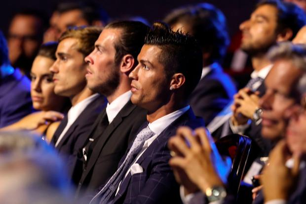 Real Madrid's Portuguese forward Cristiano Ronaldo (C) looks on during the UEFA Champions League Group stage draw ceremony, on August 25, 2016 in Monaco. / AFP PHOTO / Valery HACHEVALERY HACHE/AFP/Getty Images