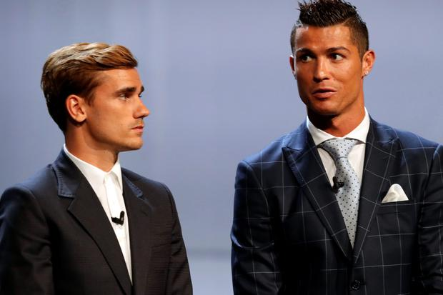 Real Madrid's Portuguese forward Cristiano Ronaldo (R) stands next to Atletico Madrid's French forward Antoine Griezmann at the end of the UEFA Champions League Group stage draw ceremony, on August 25, 2016 in Monaco. AFP PHOTO / VALERY HACHEVALERY HACHE/AFP/Getty Images