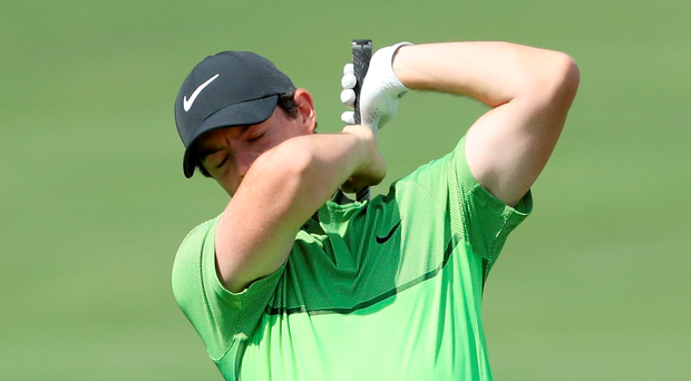 Oh no: Rory McIlroy reacts to his poor second shot on the 18th in The Barclays in New York last night